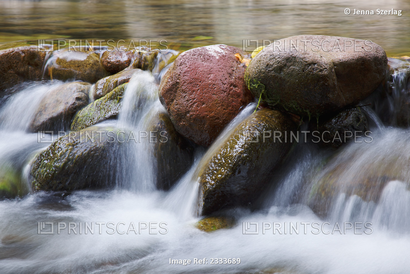 A close up of water in a river spilling over rocks; Maui hawaii united states ...